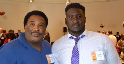 Julian Rochester (right) poses with his father Michael Roster at the Corky Kell Kickoff luncheon back in August. (Michael Carvell / AJC)