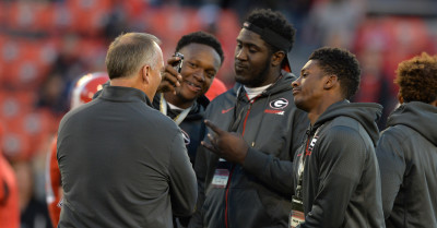 Ben Davis (far left) snaps a camera phone pic of UGA commits Julian Rochester (middle) and Chad Clay (right) prior to the UGA-Missouri game. (Brant Sanderlin / AJC)