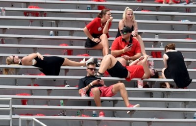 Fans wait for the game to resume Saturday at Sanford Stadium. (Brant Sanderlin / AJC)
