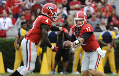Brice Ramsey, seen here with Keith Marshall, got playing time in both halves. (John Kelley / UGA)