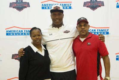 E.J. Price, Jr. poses with his father at his Under Armour All-American jersey presentation on Friday, Oct. 9, 2015. (Special)