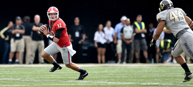 UGA quarterback Brice Ramsey looks down field late in the first half against Vanderbilt. (Brant Sanderlin/ AJC)