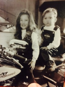 Elle and Isaac Nauta pose on one of the family's Harleys during their youth. (Special)