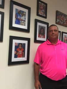 Lambert's photo is prominently displayed on the wall of fame in the office of Wayne County football coach and athletic director Jody Grooms. (AJC / CHIP TOWERS)