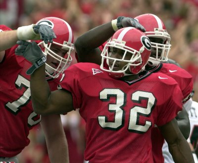 Smith had a five-year career in the NFL after being selected in the third round of the 2003 draft. (Brant Sanderlin / AJC)