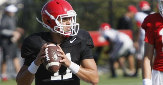 UGA quarterback Greyson Lambert waits for an open wide receiver during Tuesday's practice. Coaches have focused on running the ball in games while Lambert gets comfortable in live action. (Joshua L. Jones/Special)