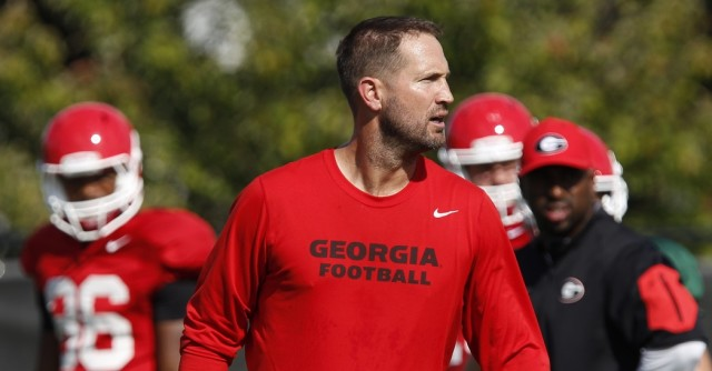 UGA offensive coordinator Brian Schottenheimer looks on during quarterback drills during Wednesday's practice. The UGA offense has developed a balance attack between the run and pass under Schottenheimer.(Joshua L. Jones/Special)