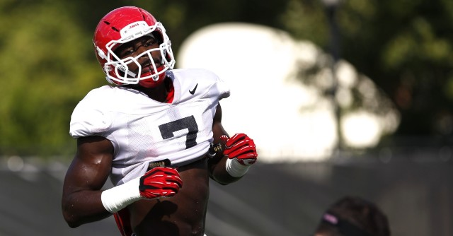 UGA outside linebacker Lorenzo Carter (7) finishes a drill during Wednesday's practice. (Joshua L. Jones/Special)