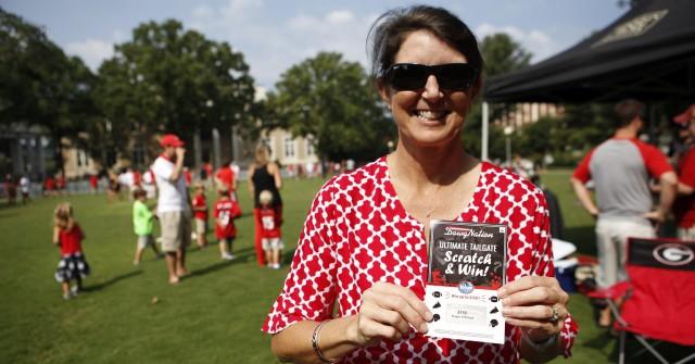 Jiyne Ann Milling poses with her $150 Kroger scratch-off winning ticket. (Joshua L. Jones/ Special)