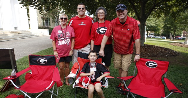 Brice Payne, eight years old, and his family are ready to cheer on their favorite football team. (Joshua L. Jones/ Special)