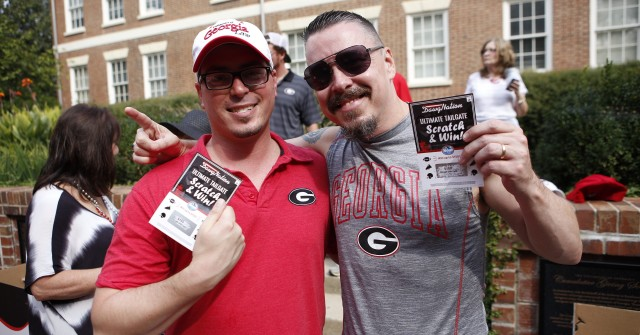 Michael Baker and Shannon Jackson are on their way to the stadium. (Joshua L. Jones/ Special)