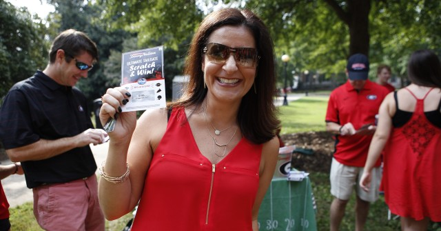Sissy Williams is enjoying this perfect tailgate atmosphere. (Joshua L. Jones/ Special)