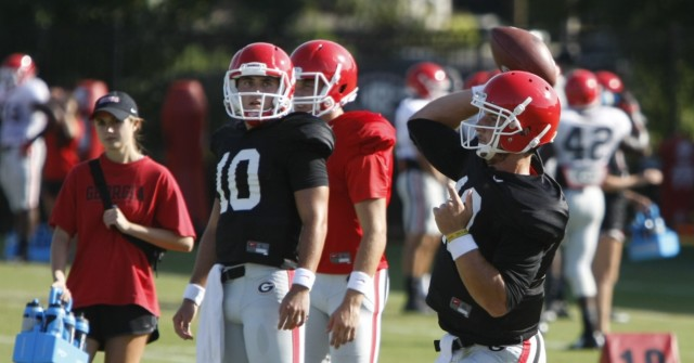 UGA quarterback Faton Bauta throws during a pass Tuesday's practice. Although Lambert hasn't wowed UGA fans through the first two games, Mark Richt insists there is not an open competition at quarterback. (Joshua L. Jones/ Special)