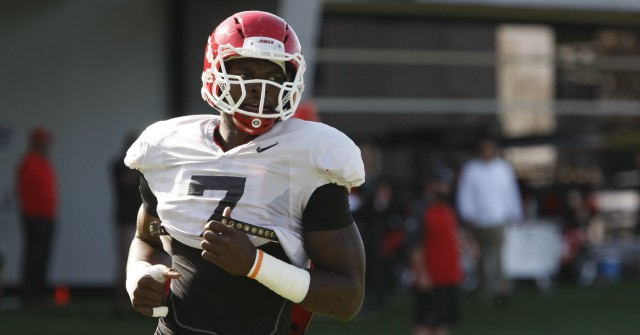 UGA outside linebacker Lorenzo Carter finishes a drill during Tuesday's practice. Carter was ejected from UGA's game against Vanderbilt for targeting in the first quarter and some believe he is in the coaches' doghouse. (Joshua L. Jones/ Special)