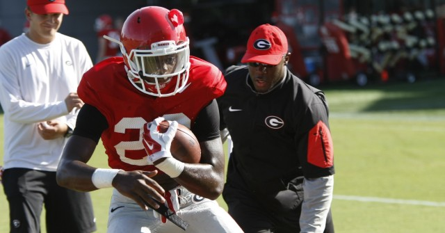 UGA tailback Avery McNeely is coached by running backs coach Thomas Brown during drills at Tuesday's practice. (Joshua L. Jones/Special)