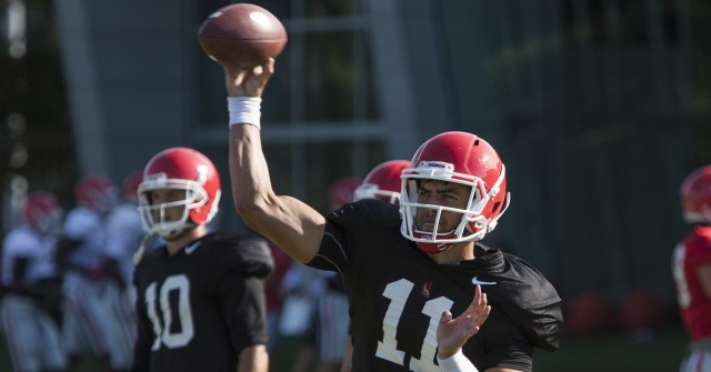 UGA quarterback Greyson Lambert  throws a pass during Tuesday's practice. Lambert will remain Georgia's starting quarterback for Saturday's game, according to coach Mark Richt. (Joshua L. Jones/Special)