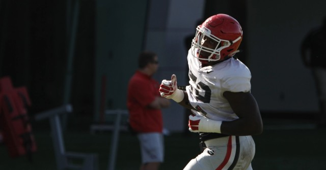 UGA outside linebacker Jordan Jenkins finishes a drill during Tuesday's practice. Jenkins was the Bulldogs' leading tackler against Vanderbilt with 11 tackles and two sacks. (Joshua L. Jones/Special)