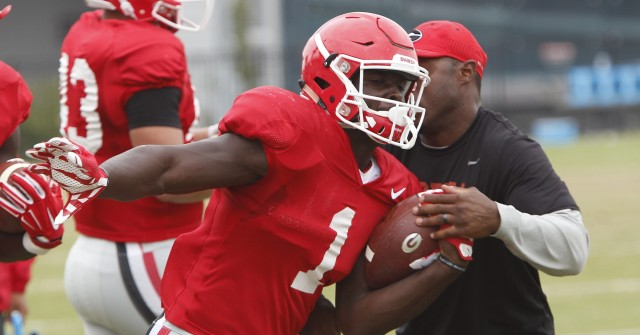 UGA tailback Sony Michel (1) runs a drill during Tuesday's practice.
