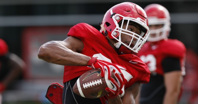 UGA tight end Jordan Davis (85) try's to bring in a pass from UGA quarterback Brice Ramsey (12) during Wednesday's practice.