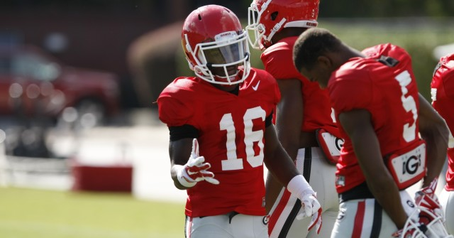 UGA wide receiver Isaiah McKenzie (16) gives freshmen teammate UGA wide receiver Terry Godwin (5) a pep talk in-between drills during Wednesday's practice. (Joshua L. Jones/Special)