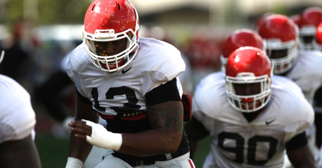 UGA defensive end Jonathan Ledbetter (13) runs a drill during Wednesday's practice. (Joshua L. Jones/Special)