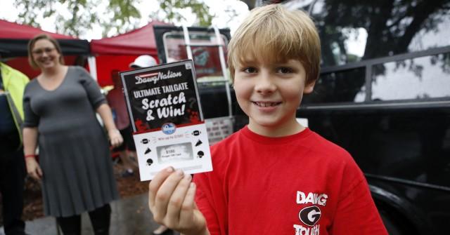 Sawyer Maddox, from Atlanta, Ga., want let the rain stop him from cheering on the Bulldogs. (Joshua L. Jones/Special)