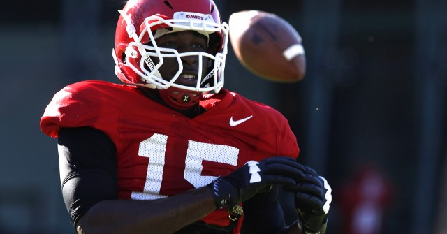 UGA linebacker D'Andre Walker (15) misses a pass at Tuesday's practice. (Joshua L. Jones/Special)