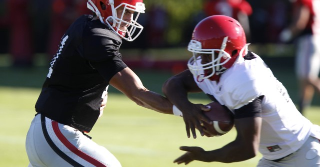 UGA quarterback Greyson Lambert (11) hand off the ball to tailback Nick Chubb (27) at Tuesday's practice. Lambert was pulled and replaced by backup quarterback Brice Ramsey after throwing seven incompletions in the second quarter of last Saturday's loss to Alabama. (Joshua L. Jones/Special)