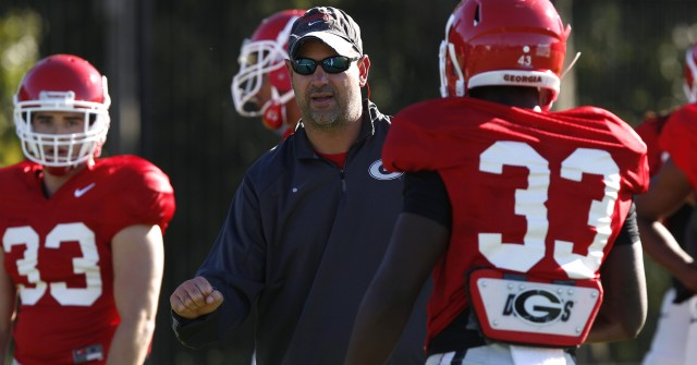 UGA defensive coordinator Jeremy Pruitt speaks with defensive back Kirby Choates (33) at Tuesday's practice. (Joshua L. Jones/Special)