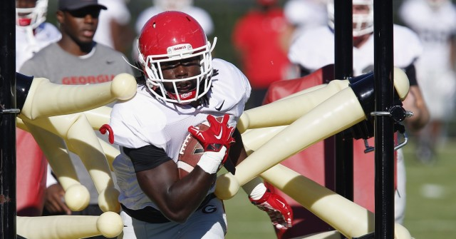 UGA tailback Keith Marshall (4) runs a drill at Tuesday's practice. Marshall had one rushing attempt for 6 yards in Saturday's loss to Alabama. (Joshua L. Jones/Special)