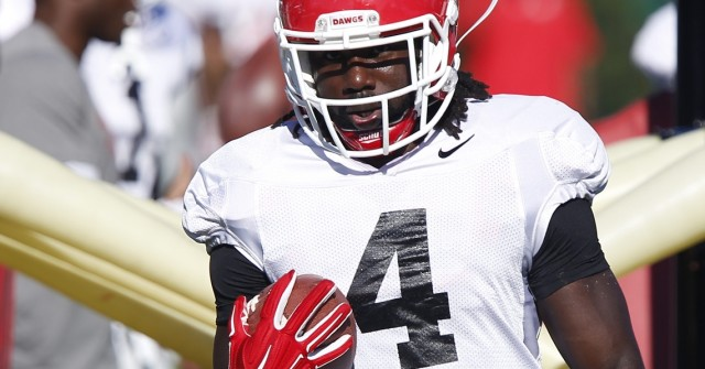 UGA tailback Keith Marshall (4) finishes a drill at Tuesday's practice. (Joshua L. Jones/Special)