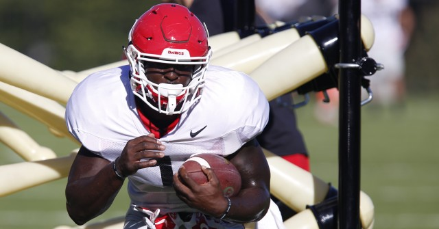 UGA tailback Sony Michel (1) runs a drill at Tuesday's practice. Michel had nine rushing attempts for 53 yards and one reception in Saturday's loss to Alabama. (Joshua L. Jones/Special)