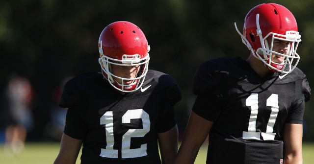 UGA quarterback Greyson Lambert (11) and quarterback Brice Ramsey (12) move on to the next drill during Wednesday's practice. (Joshua L. Jones/Special)