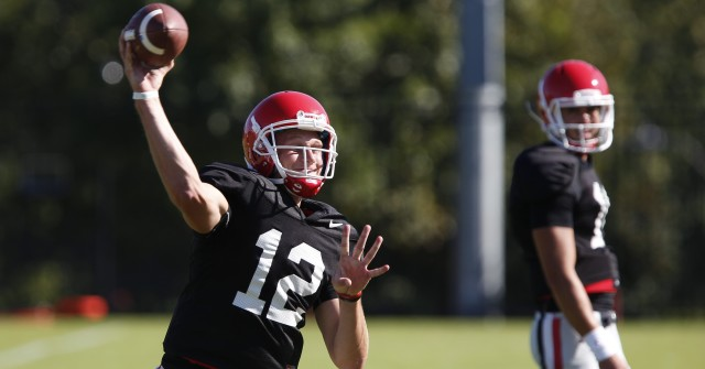 UGA quarterback Brice Ramsey (12) looks for an open wide receiver at Wednesday's practice while quarterback Greyson Lambert (11) looks on. (Joshua L. Jones/Special)