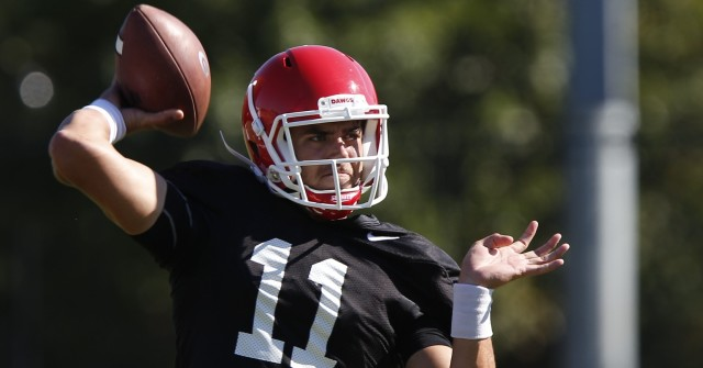 UGA quarterback Greyson Lambert (11) looks for an open wide recover at Wednesday's practice. Lambert will start against Tennessee this weekend. (Joshua L. Jones/Special)