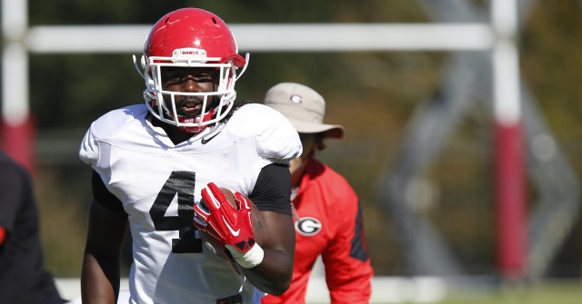 UGA tailback Keith Marshall (4) runs a drill at Tuesday's practice. last time Mitchell played in Knoxville he went out in the first quarter with an injury. (Joshua L. Jones/Special)