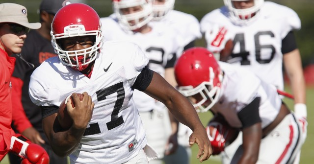 UGA tailback Nick Chubb (27) finishes a drill at Wednesdays practice. Chubb could break Herschel Walker's school record of thirteen games with 100 rushing yards in this weekends game against Tennessee. (Joshua L. Jones/Special)