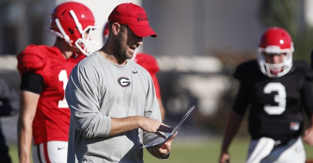 UGA offensive coordinator Brian Schottenheimer calls out commands at Tuesday's practice. Schottenheimer's offense came away with only four third-down conversions out of 14 attempts in Saturday's loss at Tennessee. (Joshua L. Jones/Special)