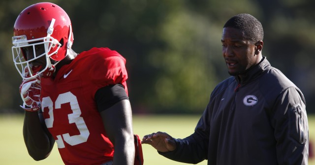 UGA wide receivers coach Bryan McClendon works with wide receiver Shakenneth Williams (23) at Tuesday's practice. (Joshua L. Jones/Special)