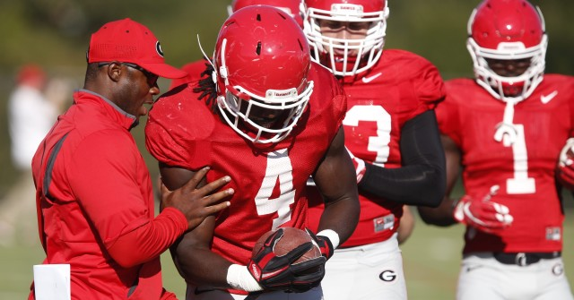 UGA running backs coach Thomas Brown works with tailback Keith Marshall (4) during at Tuesday's practice. Marshall and the other backs are looking to fill the massive loss to the teams running game after tailback Nick Chubb's knee injury in Saturday's loss to Tennessee. (Joshua L. Jones/Special)