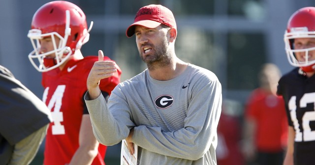 UGA offensive coordinator Brian Schottenheimer gives instructions at Wednesday's practice. (Joshua L. Jones/Special)