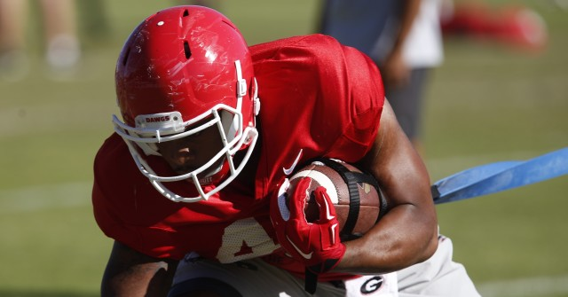 UGA fullback Quayvon Hicks (48) runs a drill at Wednesday's practice. Hicks has been working with the fullback and tailback unit this week. (Joshua L. Jones/Special)