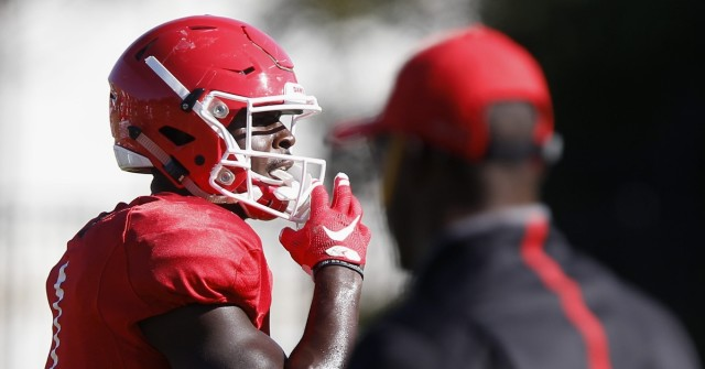 UGA running backs coach Thomas Brown looks on as tailback Sony Michel (1) prepares to run a drill with at Wednesday's practice.