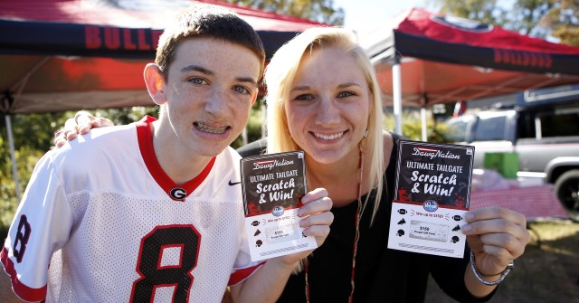 13-year-old, Noah Nicholson, left, from Waleska, Ga., and Raychale Dukeman, from Canton, Ga., are ready for the big homecoming game. (Joshua L. Jones/Special)