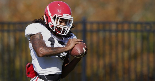 UGA defensive back Juwuan Briscoe (12) runs a drill at Wednesday's practice.