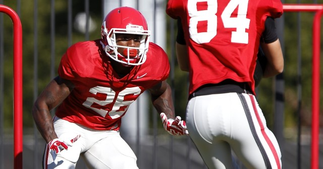 UGA split end Malcolm Mitchell (26) runs a drill at Wednesday's practice. Mitchell was the team leader with seven catches for 49 yards in Saturday's win over Missouri. (Joshua L. Jones/Special)