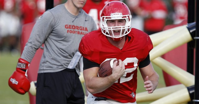 UGA tailback Brendan Douglas (22) runs a drill at Thursday's practice. Douglas had nine carries for 24 yard in the teams win over Missouri last Saturday. (Joshua L. Jones/Special)
