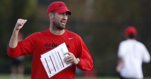 UGA offensive coordinator Brian Schottenheimer directs the offense at Thursday's practice. Schottenheimer and the other coaches are treating the bye week as a mini camp in hopes of getting the offense back in gear. (Joshua L. Jones/Special)