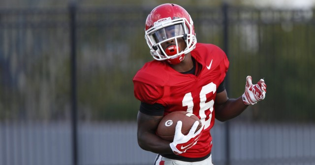 UGA wide receiver Isaiah McKenzie (16) looks to the sideline for directions from wide receivers coach Bryan McClendon at Thursday's practice. (Joshua L. Jones/Special)