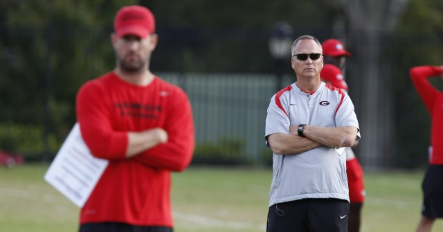 UGA head coach Mark Richt and offensive coordinator Brian Schottenheimer look on during Thursday's practice. (Joshua L. Jones/Special)'